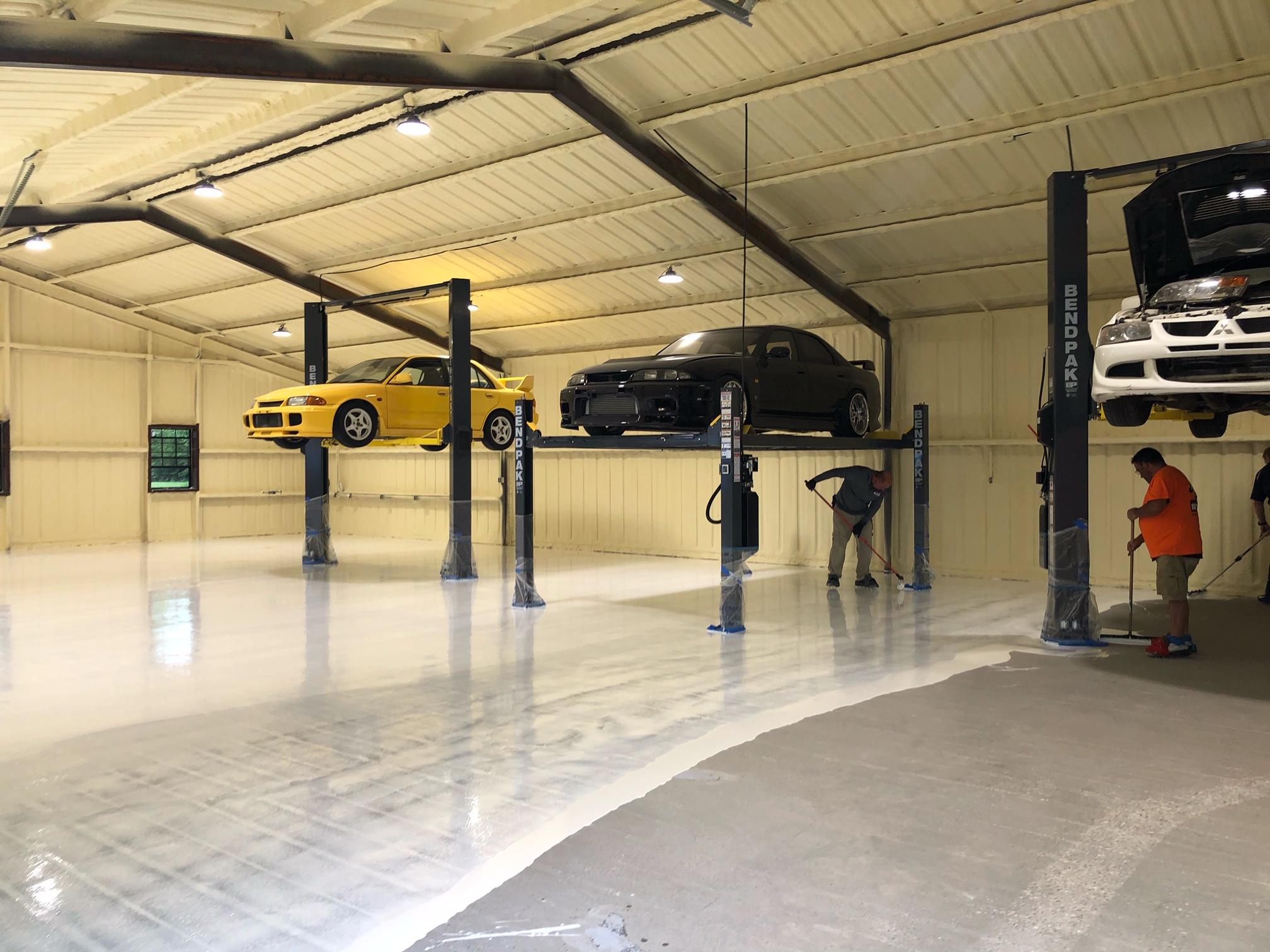 VAPOR BAN ER moisture vapor barrier being installed at Evan Shanks garage