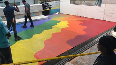Top coating the floor with SPARTACOTE™ FLEX PURE™ polyurea sealer/finish