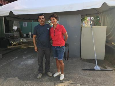 Ryan Ali with Leslie Warner, Chairperson, Project CareTT