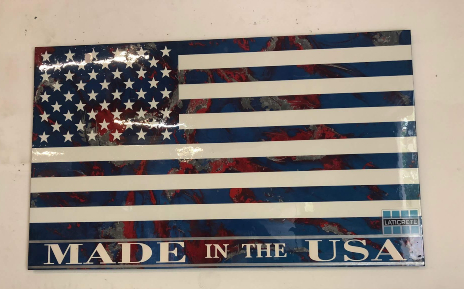 American flag made out of SPARTACOTE resinous flooring products from LATICRETE hanging over the office door at Desoto Sales, Inc. in North Highlands, California