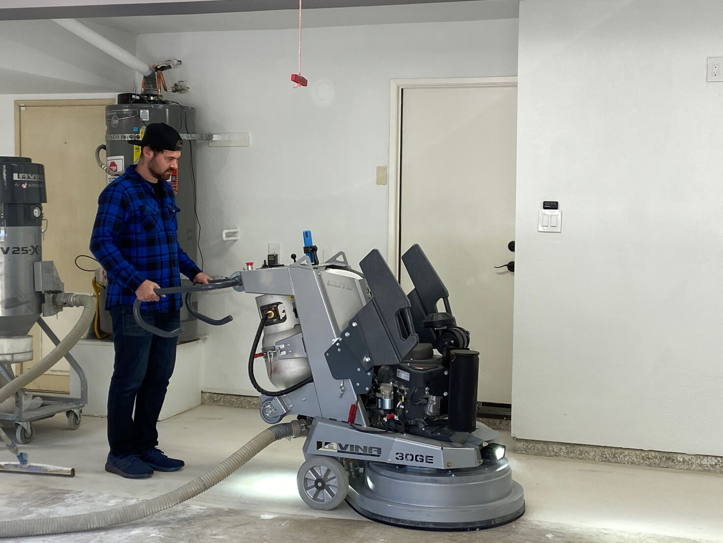 Evan Beckerman helping to prep the garage floor for LATICRETE resinous coatings