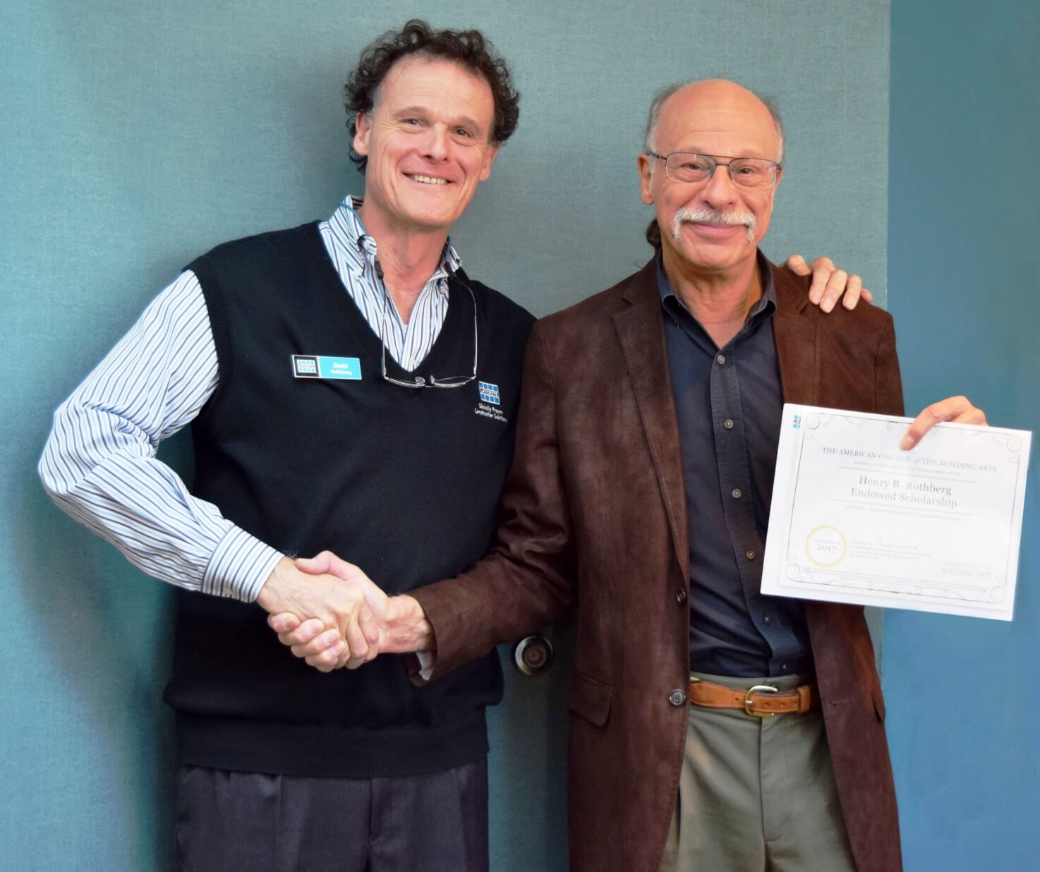Henry B. Rothberg receives 50 year service award from David Rothberg